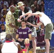Jeff Carey had his hair clipped by Kenny Gregory, left, Eric Chenowith, center, and Luke Axtell at the 2000 Late Night.