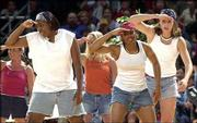 Kansas women players Jaclyn Johnson, left, Selena Scott and Brooke Reves participated in a skit during the 2000 Late Night.