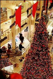 Last-minute holiday shopping at the Manhattan Mall in New York City is light due to a heavy storm hitting the city the day before Christmas, in this Dec. 24, 2003, file photo. Retailers are uncertain what to expect for holiday profits after slow back-to-school sales this year.