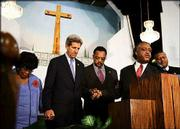 Democratic presidential candidate Sen. John Kerry, D-Mass., holds hands in prayer with retired Rep. Carrie Meek, D-Fla., left, the Rev. Jesse Jackson, center, the Rev. Al Sharpton, second right, and Pastor Gaston Smith on Sunday at the Friendship Missionary Baptist Church in Miami.