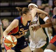 Connecticut's Lindsay Whalen, left, tries to brush past Seattle's Betty Lennox in the Storm's 67-65 victory. Lennox had 27 points in the game Sunday in Seattle, helping the Storm force a decisive Game 3 in the WNBA Finals.