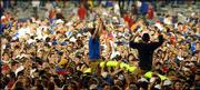 Kansas University fans haul the Memorial Stadium goalposts to Potter Lake after the Jayhawks beat Kansas State. The KU victory Saturday prompted a mass of students and fans to rush onto the field, tearing down the goalposts and causing minor damage.