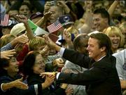 Democratic vice presidential candidate John Edwards greets the crowd during a campaign stop at Municipal Auditorium in Kansas City, Mo. Edwards criticized President Bush on Monday for not naming any mistakes he'd made while in office; the question was posed during Friday's debate.