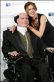 "Christopher Reeve poses for photographers with his wife, Dana, in this Nov 24, 2003, file photo. Reeve continued acting after his accident and won a Screen Actors Guild award for his performance in the television remake of ""Rear Window."""