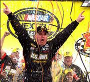 Joe Nemechek celebrates his victory in the Banquet 400. He won Sunday at Kansas Speedway in Kansas City, Kan.