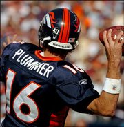 Denver quarterback Jake Plummer's helmet carries a No. 40 sticker in honor of former teammate Pat Tillman, who was killed in Afghanistan. Plummer wore the sticker during Sunday's game in Denver. He agreed Wednesday to stop wearing the sticker, and the NFL agreed to find other ways to honor the slain soldier.