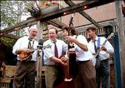 "Kory Willis, left, Paul Schmidt, Mike Horan and Leo Posch formed The Midday Ramblers in the late 1990s. On Sunday, the Lawrence quartet, shown performing at The Replay Lounge, 946 Mass., will celebrate the release of its third album, ""Bluegrass Music is Fun!"""