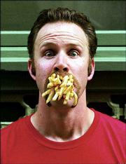 "Morgan Spurlock, the director/star of ""Super Size Me,"" will relate his experiences battling McDonald&squot;s while in Lawrence on Monday."