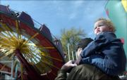 "Jeffrey Smrha-Monroe, 18 months, takes in the sights of the carnival at the Maple Leaf Festival from atop the shoulders of John Monroe. The two were waiting for Jeffrey&squot;s older brother to finish the ride at Saturday&squot;s annual fall festival in Baldwin.<br> <a href= ""http://etc.lawrence.com/galleries/mapleleaf04/5583_lores.html"" target=""_new"" onclick= ""window.open(&squot;http://etc.lawrence.com/galleries/mapleleaf04/5583_lores.html&squot;,&squot;Photo&squot;,&squot;height=650,width=550,screenX=10,screenY=10,&squot; + &squot;scrollbars,resizable&squot;); return false;""> <img src=""http://www.ljworld.com/art/icons/icon_photo.gif"" border= ""0"" alt=""photo""> Photo Gallery: 2004 Maple Leaf Festival</a><br>"