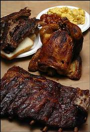 Lawrence residents no longer need to drive to Kansas City to find barbecued fare such as these ribs and chicken. Lawrence has six establishments that are ready to help satisfy cravings for smoked meats.