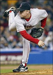Boston's Curt Schilling delivers against New York. Schilling held the Yankees to one run in seven innings, and the Red Sox won, 4-2, Tuesday night in New York.