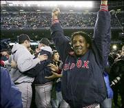 Boston pitcher Pedro Martinez celebrates with teammates after the Red Sox beat the New York Yankees in Game 7 of the AL championship series. Boston won, 10-3, Wednesday in New York to complete a comeback from an 0-3 series deficit.