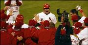 St. Louis slugger Jim Edmonds, center, is mobbed by teammates after his two-run home run in the 12th inning. Edmonds' blast gave the Cardinals a 6-4 victory over the Houston Astros on Wednesday in St. Louis, forcing a Game 7 of the N L championship series.