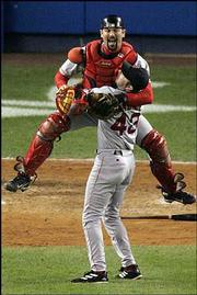Boston catcher Jason Varitek leaps into the arms of pitcher Alan Embree after the Red Sox beat the Yankees, 10-3.