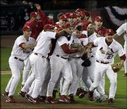 St. Louis' Scott Rolen (27), who hit a two-run home run in the sixth inning, leads his teammates in celebration after their 5-2 victory over Houston. The Cardinals won Game 7 and the NL championship series Thursday night at Busch Stadium in St. Louis. They will face the Boston Red Sox in the World Series.
