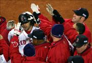 Boston's Mark Bellhorn is mobbed by teammates after his decisive two-run home run. The eighth-inning blast gave the Red Sox an 11-9 victory Saturday night in Boston.