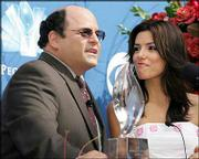 "Jason Alexander, left, and Eva Longoria announce nominees for the 31st annual People&squot;s Choice Awards. Longoria stars in ""Desperate Housewives,"" nominated as favorite new TV drama. Alexander stars in the TV comedy ""Listen Up."""