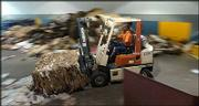 Doug King, solid waste loader, works Wednesday at the North Lawrence Recycling Center, 320 N.E. Industrial Lane, baling cardboard and newspaper. The city's Solid Waste Division has recommended against a city recycling program.
