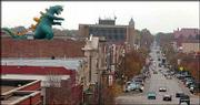 "A 28-foot Godzilla balloon is inflated on top of Liberty Hall to celebrate Kansas University&squot;s ""In Godzilla&squot;s Footsteps"" conference and film festival. The balloon inflation Thursday kicked off the conference scheduled this weekend in downtown Lawrence."