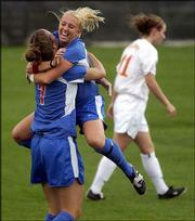 Kansas University's Rachel Gilfillan, left, is congratulated by Afton Sauer after Gilfillan's goal. The Jayhawks defeated Iowa State, 4-0, and won a share of the Big 12 Conference crown.