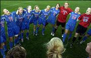 Kansas University soccer players, from left, Nikki Alvarez, Lacey Novak, Nicole Cauzillo, Monica Brothers, Afton Sauer, Kelsey Archuleta, goalie Meghan Miller, Emily Strinden and Colleen Quinn belt out the Rock Chalk chant after defeating Iowa State. The Jayhawks won, 4-0, Friday at Jayhawk Soccer Complex to earn a share of the Big 12 Conference regular-season title.