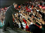 President Bush greets supporters after a campaign rally at SeaGate Convention Center Friday in Toledo, Ohio.