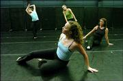 """Kansas University Dance Company members, counterclockwise from front, Morgan Fogarty, Ãllison Kant, Kristin Vaglio and Amy Hutchings rehearse """"The Bathers That Disappeared,"""" a dance by KU dance instructor Joan Stone. The piece will be performed this week at the company&squot;s fall concerts."""