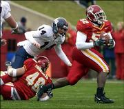 Kansas University quarterback Brian Luke (14) watches as Iowa State's Brent Curvey (52) scoops up Luke's fumble and returns it for the Cyclones' only touchdown in ISU's 13-7 victory over the Jayhawks. Kansas' offense sputtered in the setback Saturday at Jack Trice Stadium in Ames, Iowa.