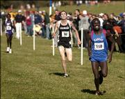 Kansas University runner Benson Chesang (110) races to the finish line ahead of Colorado's Brent Vaughn (50) and Chesang's brother, Kansas State runner Matthew Chesang. Benson Chesang won the men's title at the Big 12 Conference Cross Country Championships on Saturday in Topeka.