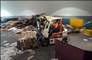 To capture a sense of motion in this image, the photographer again used a slow shutter speed. But instead of focusing on a stationary subject, he panned, or moved his camera with the forklift. The subject remains clear and identifiable against a background of blurred objects.