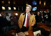 Democratic presidential candidate Sen. John Kerry, D-Mass., approaches the bar to buy a round of beers Saturday at Francie's Bar in Des Moines, Iowa.