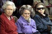 Britain's Queen Elizabeth, left, joins her aunt, Princess Alice, center, and sister Princess Margaret on Princess Alice's 100th birthday, Dec. 12, 2001. Alice, the Dowager Duchess of Gloucester, died Friday at 102.