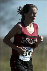 Lawrence High's Kelly Renfro runs down the stretch. Renfro placed ninth at the Class 6A state meet Saturday at Rim Rock Farm.