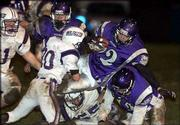 Baldwin High's Klay Garrison runs the ball against Louisburg in the second half.