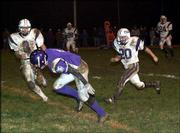 Baldwin High's Andy Hannon, front, tumbles into the end zone for a touchdown reception in the second half. The Bulldogs beat Louisburg, 28-6, Tuesday at Liston Stadium in Baldwin.