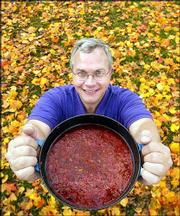 Fall time means chili time for Bill Ahrens, Lawrence's transportation planner. Ahrens, who has won the city's chili cooking contest two consecutive years, displayed a pot of his homemade chili on Friday at South Park.