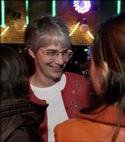 Marci Francisco is congratulated by supporters at Abe and Jake's Landing, 8 E. Sixth St., where members of the Kansas Democratic Party gathered to see Tuesday's election results. Francisco, former Lawrence mayor from 1981 to 1983, won the 2nd District Senate seat over incumbent Mark Buhler, a Republican.