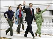 Democratic presidential candidate Sen. John Kerry, left photo, and his wife, Teresa Heinz Kerry, arrive at the Statehouse in Boston where Sen. Kerry cast his vote Tuesday.