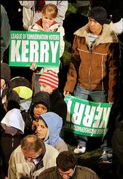 Supporters of Sen. John Kerry wait in Copley Square in Boston. Election night results trickled in Tuesday.