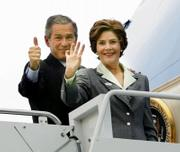 President Bush gives a thumbs-up as he and first lady Laura Bush board Air Force One in Waco, Texas. Bush voted Tuesday morning in Crawford, Texas.