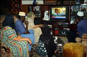 A Kenyan family watches U.S. election news at their home in Nairobi, Kenya. Sen. John Kerry, generally the favorite candidate outside of the United States, conceded the presidential race to George W. Bush on Wednesday.