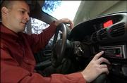 Steve Vukelich is one of a growing number of satellite radio subscribers in Lawrence. Vukelich has a Sirius system installed in his car.