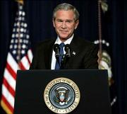 President Bush pauses during his first news conference after his re-election at the Eisenhower Executive Office Building Thursday in Washington.