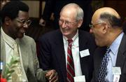 Former Kansas University basketball coach Ted Owens, center, chats with former players Tommie Smith, left, and Al Lopes.