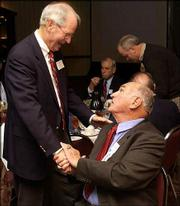 "Owens addresses former KU football coach Don Fambrough. The distinguished guests attended ""An Evening with Ted Owens and Friends,"" a benefit for the Bert Nash Center, Thursday night at the Holidome."