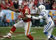 Kansas City running back Priest Holmes (31) races into the end zone past Indianapolis defender Jason David. Holmes, shown Sunday in Kansas City, Mo., and the Chiefs have scored 101 points in their last two games.