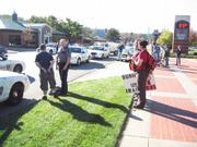 Police arrested at least two protestors Saturday in front of the Douglas County Bank on Ninth Street.
