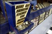 Rex's Stadium Barber Shop has a box of change that customers can use for parking meters.