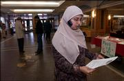 Asma Rehman, president of Muslim Student Assn. of Kansas University, chats with a friend on the phone at the Kansas Union. Rehman, a senior from Kansas City, Mo., is fasting during Ramadan. She is recruiting participants for the organization's upcoming Fast-A-Thon.