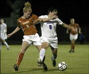 KU's Holly Gault, right, tangles with Texas' Shannon Labhart.